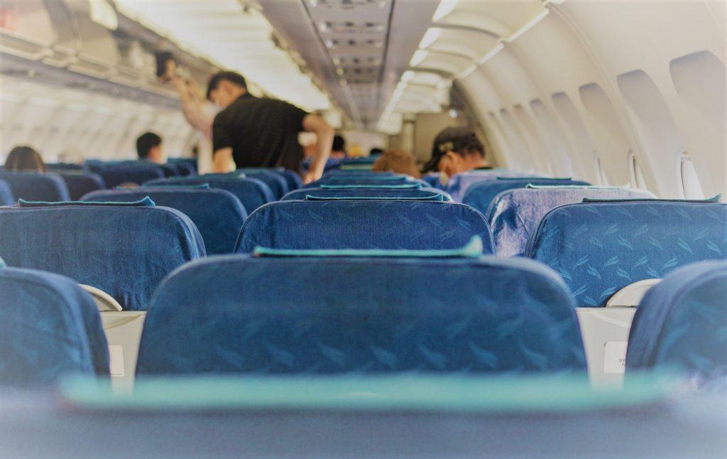 airplane cabin, wearing masks