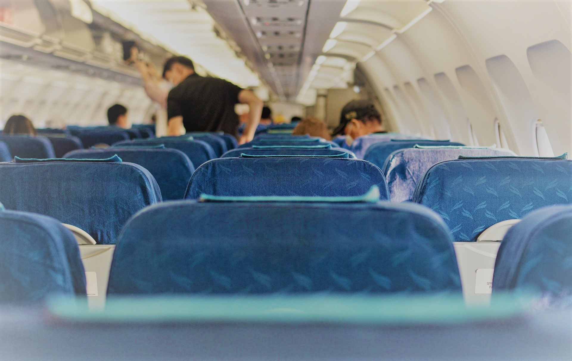 airplane cabin, wearing masks