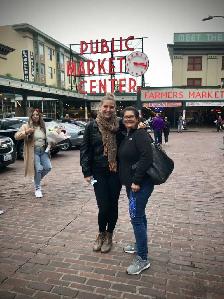 Pike Place Market, posing in front of public market, trip to Seattle